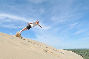 Martyn jumping off the top of the Dune du Pyla, France